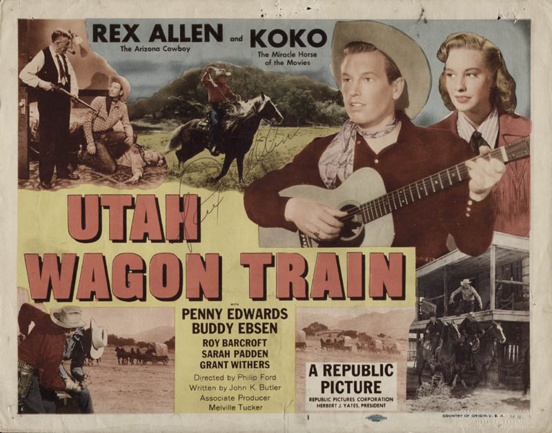 Rex Allen Signs a Lobby Card