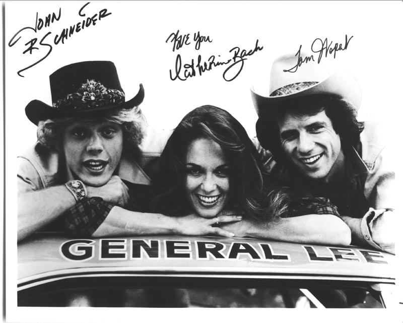 Image 1 for Dukes Of Hazzard TV Cast - Autographed Inscribed Photograph co-signed by: John Schneider, Catherine Bach, Tom Wopat - HFSID 55085