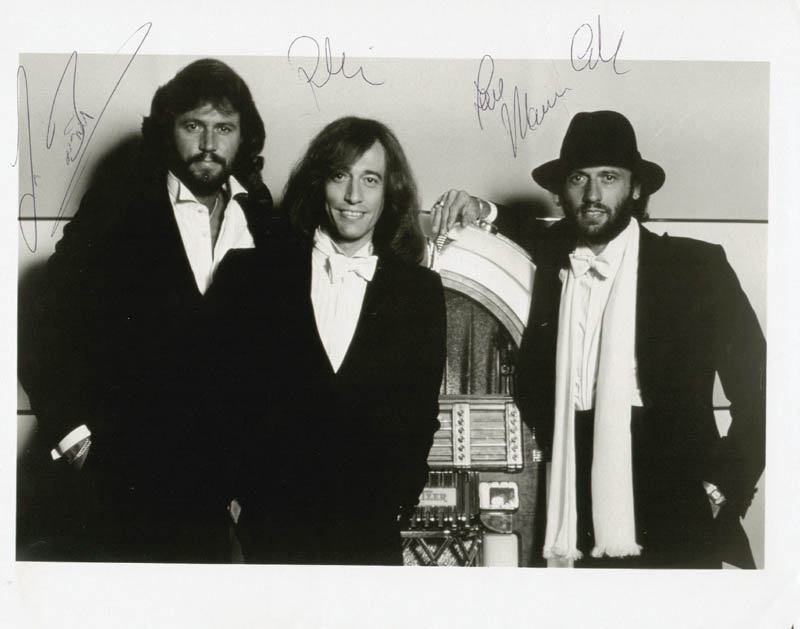 Image 1 for The Bee Gees - Autographed Signed Photograph co-signed by: The Bee Gees (Barry Gibb), The Bee Gees (Robin Gibb), The Bee Gees (Maurice Gibb) - HFSID 65569