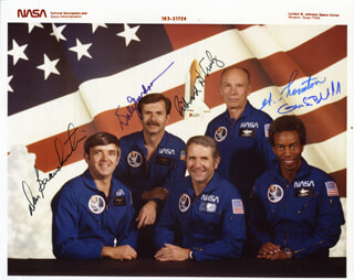 VICE ADMIRAL RICHARD H. TRULY - AUTOGRAPHED SIGNED PHOTOGRAPH CO-SIGNED BY: CAPTAIN DANIEL C. BRANDENSTEIN, WILLIAM E. THORNTON, COLONEL GUION S. GUY BLUFORD JR., COMMANDER DALE A. GARDNER