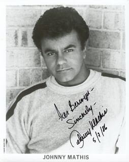 JOHNNY MATHIS - AUTOGRAPHED INSCRIBED PHOTOGRAPH 05/07/1986