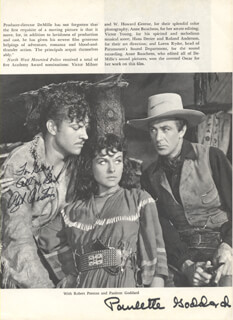 NORTHWEST MOUNTED POLICE MOVIE CAST - INSCRIBED BOOK PHOTOGRAPH SIGNED CO-SIGNED BY: PAULETTE GODDARD, ROBERT PRESTON
