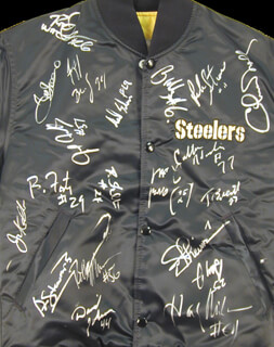 THE PITTSBURGH STEELERS - JACKET SIGNED CIRCA 1991 CO-SIGNED BY: JOE MEAN JOE GREENE, THOMAS EVERETT, JEFF BRADY, AARON JONES, BUBBY BRISTER, JERRY OLSAVSKY, DAVID JOHNSON, ADRIAN COOPER, CARLTON HASELRIG, RICHARD SHELTON, BARRY FOSTER, RICK STROM, DAVID LITTLE, JUSTIN STRZELCZYK, CHUCK NOLL, JOHN JACKSON, ROD WOODSON, JERROL WILLIAMS, GEORGE STEWART, ROB McGOVERN, GARY JONES, KENNY DAVIDSON, MIKE MULARKEY, GERALD WILLIAMS, CHRIS CALLOWAY, NEIL O'DONNELL, DELTON HALL, CARNELL LAKE, MERRIL HOGE, TOM RICKETTS, JOE THEISMANN