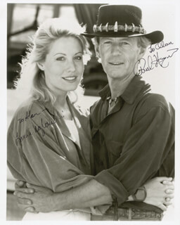 CROCODILE DUNDEE MOVIE CAST - AUTOGRAPHED INSCRIBED PHOTOGRAPH CO-SIGNED BY: PAUL HOGAN, LINDA KOZLOWSKI