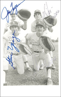 STEVE YEAGER - AUTOGRAPHED SIGNED PHOTOGRAPH CO-SIGNED BY: JOHNNY OATES, MIKE SCIOSCIA, JOE FERGUSON