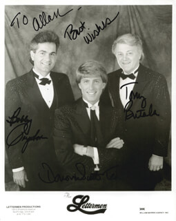THE LETTERMEN - INSCRIBED PRINTED PHOTOGRAPH SIGNED IN INK CO-SIGNED BY: THE LETTERMEN (TONY BUTALA), THE LETTERMEN (BOBBY POYNTON), THE LETTERMEN (DONOVAN TEA)
