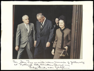 PRESIDENT LYNDON B. JOHNSON - INSCRIBED PHOTOGRAPH MOUNT SIGNED CO-SIGNED BY: FIRST LADY LADY BIRD JOHNSON