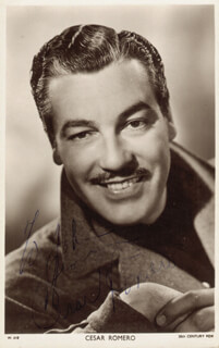 CESAR ROMERO - INSCRIBED PICTURE POSTCARD SIGNED