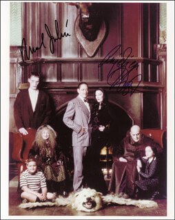 THE ADDAMS FAMILY MOVIE CAST - AUTOGRAPHED SIGNED PHOTOGRAPH CO-SIGNED BY: RAUL JULIA, ANJELICA HUSTON