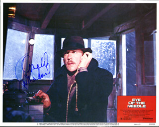 DONALD SUTHERLAND - LOBBY CARD SIGNED