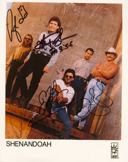 SHENANDOAH - PRINTED PHOTOGRAPH SIGNED IN INK CO-SIGNED BY: SHENANDOAH (JIM SEALES), SHENANDOAH (MARTY RAYBON), SHENANDOAH (RALPH EZELL), SHENANDOAH (MIKE MCGUIRE)