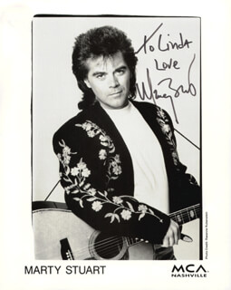 MARTY STUART - INSCRIBED PRINTED PHOTOGRAPH SIGNED IN INK