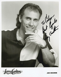 LARRY CARLTON - INSCRIBED PRINTED PHOTOGRAPH SIGNED IN INK