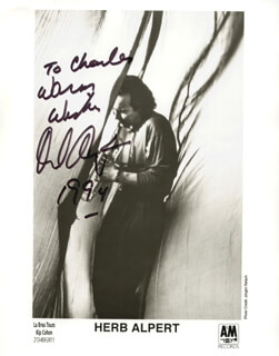 HERB ALPERT - INSCRIBED PRINTED PHOTOGRAPH SIGNED IN INK 1994