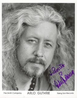 ARLO GUTHRIE - INSCRIBED PRINTED PHOTOGRAPH SIGNED IN INK