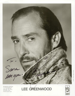 LEE GREENWOOD - INSCRIBED PRINTED PHOTOGRAPH SIGNED IN INK