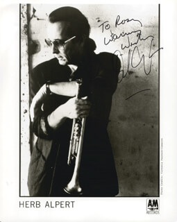 Autographs: HERB ALPERT - INSCRIBED PRINTED PHOTOGRAPH SIGNED IN INK