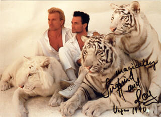 SIEGFRIED & ROY - PICTURE POST CARD SIGNED 1990 CO-SIGNED BY: SIEGFRIED & ROY (ROY HORN), SIEGFRIED & ROY (SIEGFRIED FISCHBACHER)