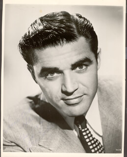 Autographs: STEVE COCHRAN - INSCRIBED PHOTOGRAPH SIGNED