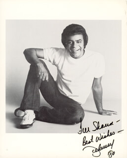 JOHNNY MATHIS - AUTOGRAPHED INSCRIBED PHOTOGRAPH 1980