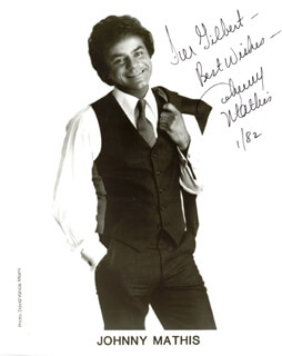 JOHNNY MATHIS - AUTOGRAPHED INSCRIBED PHOTOGRAPH 1/1982
