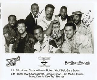 KOOL & THE GANG - AUTOGRAPHED SIGNED PHOTOGRAPH CO-SIGNED BY: KOOL & THE GANG (ROBERT KOOL BELL), KOOL & THE GANG (CURTIS WILLIAMS), KOOL & THE GANG (GEORGE FUNKY BROWN), KOOL & THE GANG (DENNIS DEE TEE THOMAS)