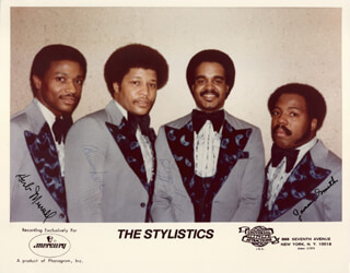THE STYLISTICS - AUTOGRAPHED SIGNED PHOTOGRAPH CO-SIGNED BY: THE STYLISTICS (RUSSELL THOMPKINS, JR.), THE STYLISTICS (AIRRION LOVE), THE STYLISTICS (HERB MURRELL), THE STYLISTICS (JAMES SMITH)