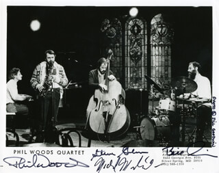 PHIL WOODS QUARTET - PRINTED PHOTOGRAPH SIGNED IN INK CO-SIGNED BY: PHIL WOODS, PHIL WOODS QUARTET (STEVE GILMORE), PHIL WOODS QUARTET (MIKE MELILLO), PHIL WOODS QUARTET (BILL GOODWIN)