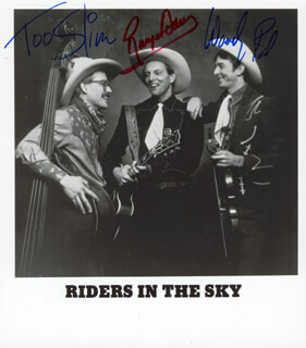 THE RIDERS IN THE SKY - PRINTED PHOTOGRAPH SIGNED IN INK CO-SIGNED BY: THE RIDERS IN THE SKY (FRED TOO SLIM LA BOUR), RIDERS IN THE SKY (PAUL WOODY PAUL CHRISMAN), RIDERS IN THE SKY, THE (DOUGLAS GREEN)
