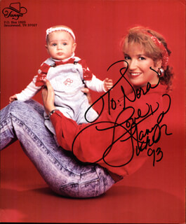 TANYA TUCKER - INSCRIBED PRINTED PHOTOGRAPH SIGNED IN INK 1993