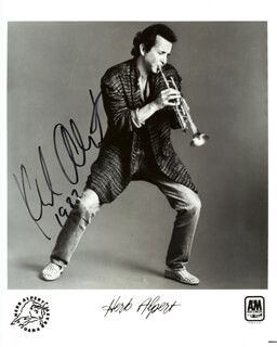 HERB ALPERT - PRINTED PHOTOGRAPH SIGNED IN INK 1987