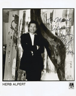 Autographs: HERB ALPERT - INSCRIBED PRINTED PHOTOGRAPH SIGNED IN INK 1990