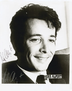 Autographs: HERB ALPERT - PRINTED PHOTOGRAPH SIGNED IN INK TWICE