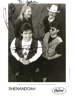 SHENANDOAH - INSCRIBED PRINTED PHOTOGRAPH SIGNED IN INK CO-SIGNED BY: SHENANDOAH (JIM SEALES), SHENANDOAH (MARTY RAYBON), SHENANDOAH (RALPH EZELL), SHENANDOAH (MIKE MCGUIRE)
