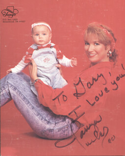TANYA TUCKER - INSCRIBED PRINTED PHOTOGRAPH SIGNED IN INK 1990
