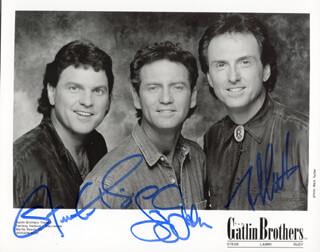 THE GATLIN BROTHERS - AUTOGRAPHED SIGNED PHOTOGRAPH CO-SIGNED BY: THE GATLIN BROTHERS (LARRY GATLIN), THE GATLIN BROTHERS (RUDY GATLIN), THE GATLIN BROTHERS (STEVE GATLIN)