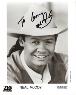 NEAL MCCOY - INSCRIBED PRINTED PHOTOGRAPH SIGNED IN INK