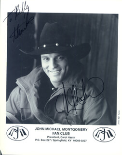 JOHN MICHAEL MONTGOMERY - INSCRIBED PRINTED PHOTOGRAPH SIGNED IN INK