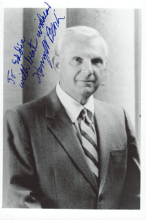 Autographs: HENRY W. BLOCH - INSCRIBED PHOTOGRAPH SIGNED