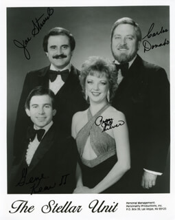 THE STELLAR UNIT - AUTOGRAPHED SIGNED PHOTOGRAPH CO-SIGNED BY: THE STELLAR UNIT (JOE STROUD), THE STELLAR UNIT (CARLOS DONAHO), THE STELLAR UNIT (GENE KEAN), THE STELLAR UNIT (PEGGY SILVER)