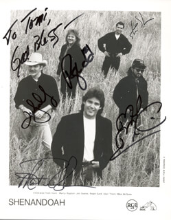 SHENANDOAH - INSCRIBED PRINTED PHOTOGRAPH SIGNED IN INK CO-SIGNED BY: SHENANDOAH (JIM SEALES), SHENANDOAH (MARTY RAYBON), SHENANDOAH (RALPH EZELL), SHENANDOAH (STAN THORN), SHENANDOAH (MIKE MCGUIRE)