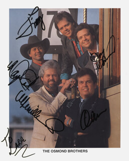 THE OSMONDS - AUTOGRAPHED SIGNED PHOTOGRAPH CO-SIGNED BY: THE OSMONDS (ALAN OSMOND), THE OSMONDS (JAY OSMOND), THE OSMONDS (MERRILL OSMOND), THE OSMONDS (JIMMY OSMOND), THE OSMONDS (WAYNE OSMOND)