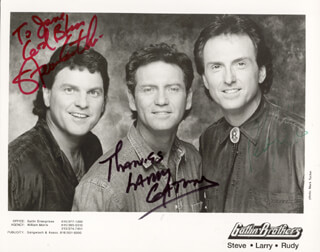 THE GATLIN BROTHERS - AUTOGRAPHED INSCRIBED PHOTOGRAPH CO-SIGNED BY: THE GATLIN BROTHERS (LARRY GATLIN), THE GATLIN BROTHERS (RUDY GATLIN), THE GATLIN BROTHERS (STEVE GATLIN)