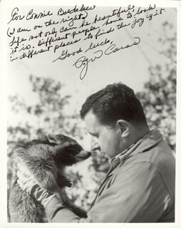 Autographs: ROGER CARAS - AUTOGRAPH NOTE ON PHOTOGRAPH SIGNED