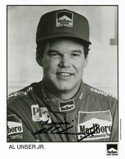 AL UNSER JR. - INSCRIBED PRINTED PHOTOGRAPH SIGNED IN INK