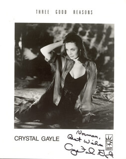 CRYSTAL GAYLE - INSCRIBED PRINTED PHOTOGRAPH SIGNED IN INK