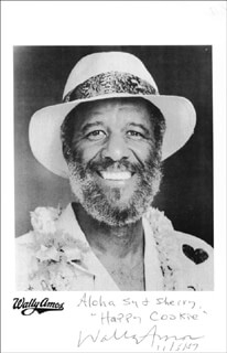 Autographs: WALLY FAMOUS AMOS AMOS - INSCRIBED PHOTOGRAPH SIGNED 11/05/1987