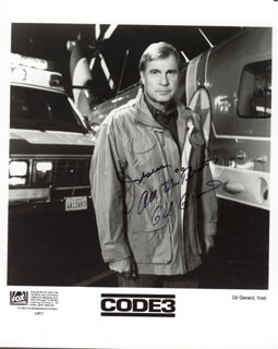 GIL GERARD - INSCRIBED PRINTED PHOTOGRAPH SIGNED IN INK