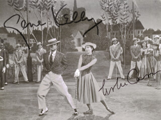 AN AMERICAN IN PARIS MOVIE CAST - MAGAZINE PHOTOGRAPH SIGNED CO-SIGNED BY: LESLIE CARON, GENE KELLY