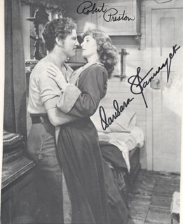 UNION PACIFIC MOVIE CAST - MAGAZINE PHOTOGRAPH SIGNED CO-SIGNED BY: BARBARA STANWYCK, ROBERT PRESTON